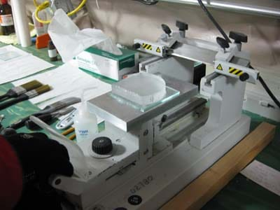 A section of ice being smoothed on a microtome