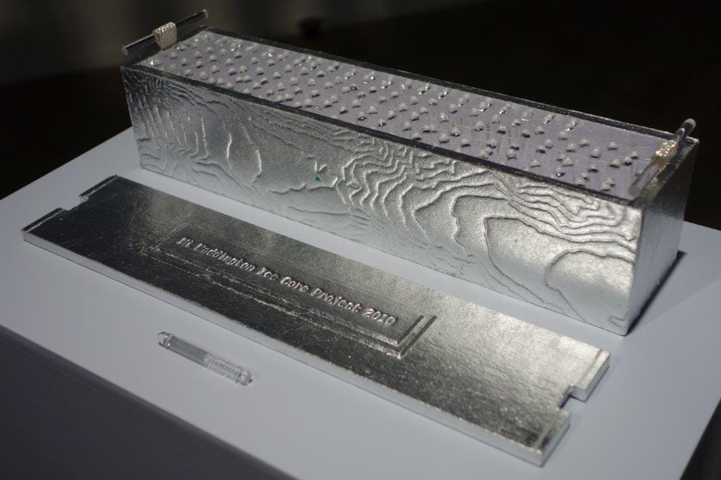 The relics, ice core water from each meter of the core, numbered and sealed in glass tubes, and housed in a aluminum-leafed box